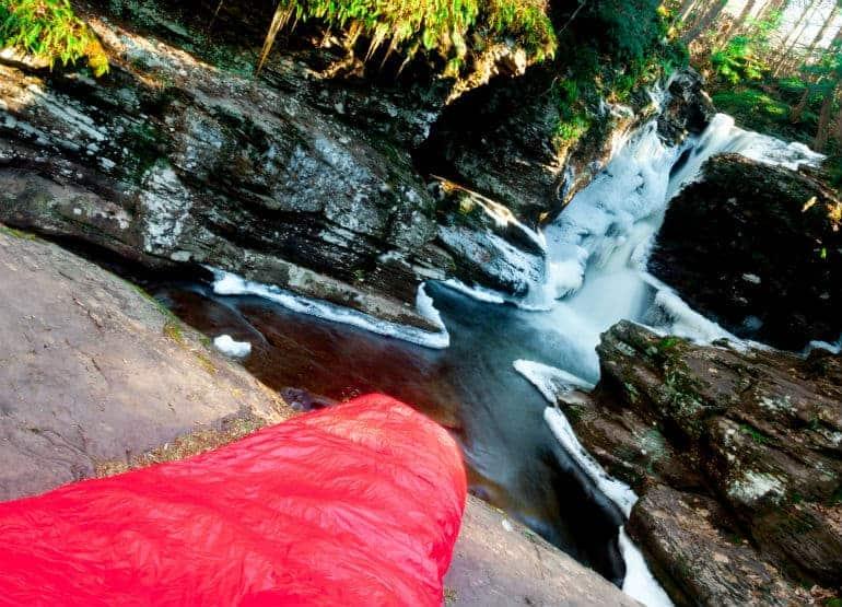 sleeping bag by river